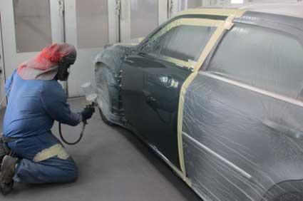 man painting vehicle